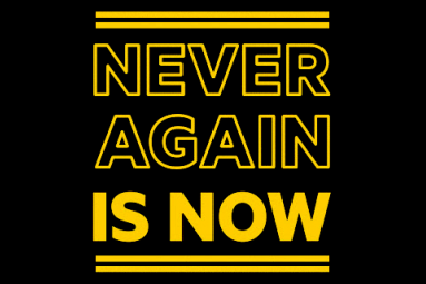 Banner saying Never Again Is Now