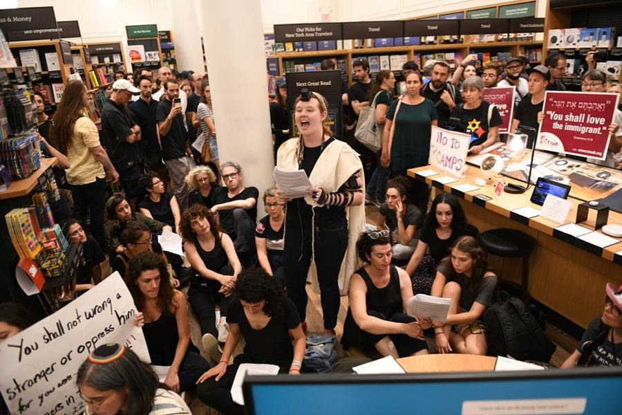 JFREJ members sit inside NYC's Amazon store