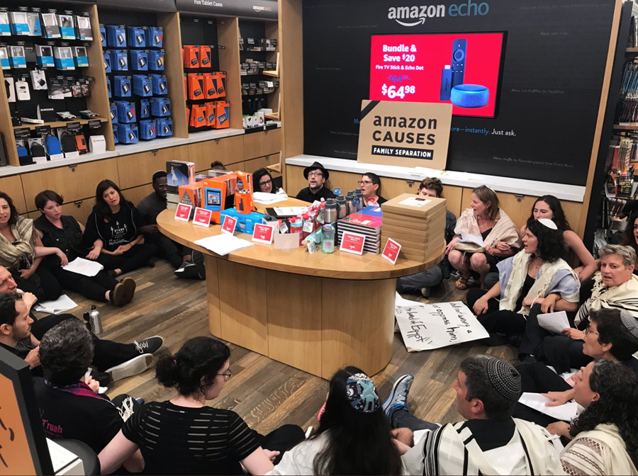 JFREJ members sit inside the Amazon Store in NYC