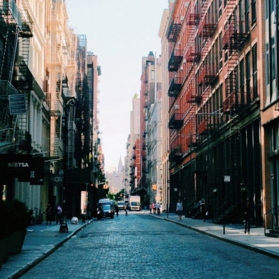 Placeholder image features a photo of a brick-covered street in NYC